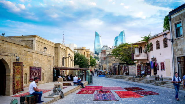 tl the street life of the baku city. flame towers and tv tower on the background / azerbaijan, baku - baku video stock e b–roll