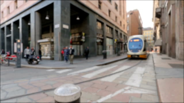 the street with buildings in the center of milan, italy - christianity stock videos and b-roll footage