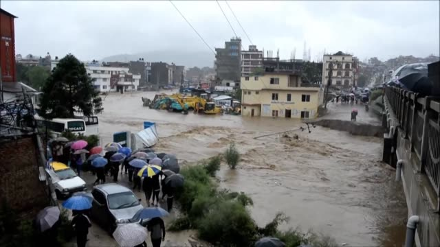 vídeos de stock e filmes b-roll de the streets of kathmandu are flooded after torrential monsoon rains induced floods and landslides killing at least 15 across nepal - monção
