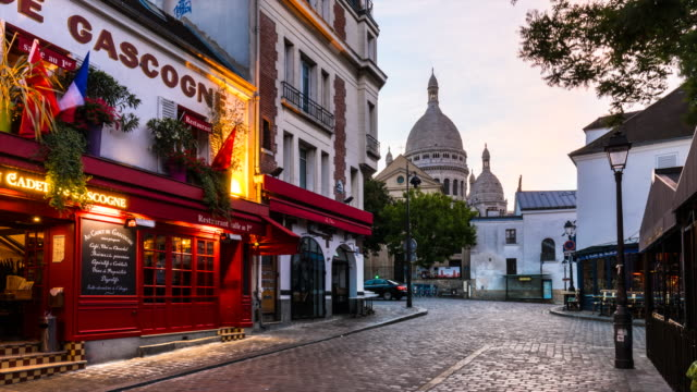 the streets of montmatre and scare coeur cathedral in the early morning, tl - basilique du sacre coeur montmartre stock videos & royalty-free footage