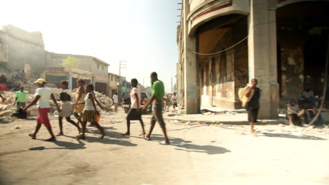 the streets of port-au-prince with building debris on the edge of the street after the haiti earthquake of january 2010 - 自然界点の映像素材/bロール
