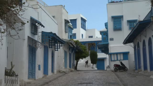 the streets of the tunisian touristic landmark of sidi bou said lie almost empty after tunisian president kais saied ordered a nationwide - tunis stock videos & royalty-free footage