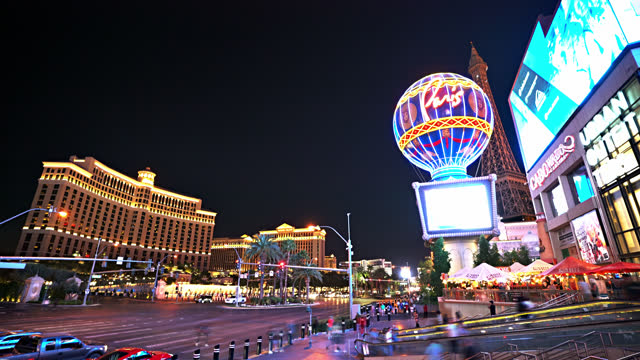 the strip. las vegas. night. fountain. - las vegas replica eiffel tower stock videos & royalty-free footage