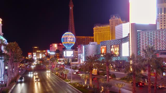 the strip. las vegas. paris hotel. night - paris las vegas stock videos & royalty-free footage
