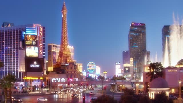 the strip. paris hotel. eifel tower. the strip and fountains of bellagio - paris las vegas stock videos & royalty-free footage