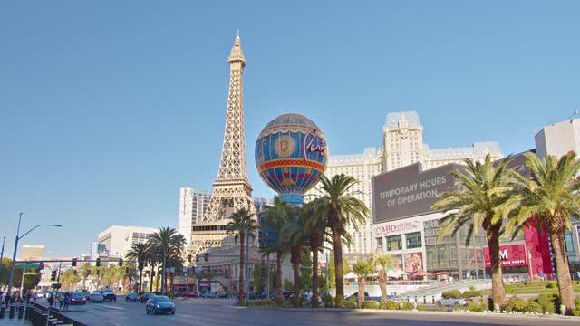the strip. paris hotel. - las vegas replica eiffel tower stock videos & royalty-free footage