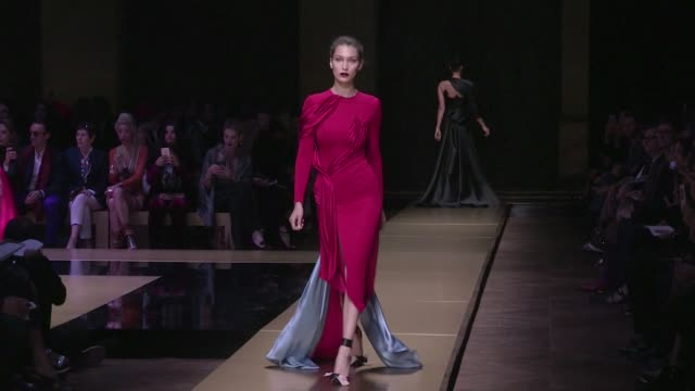 The stunning Lady in red Bella Hadid on the runway for the Atelier Versace Haute Couture Fashion show in Paris Sunday 3rd July 2016 Paris France
