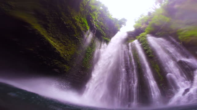the stunning waterfall with wild nature and swimming pool in indonesia during travel vacations. - tropischer regenwald stock-videos und b-roll-filmmaterial