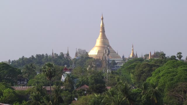 The stupa of Shwedagon Pagoda stands above trees in Yangon Myanmar on Tuesday March 7 The Seing Yaung Chi Pagoda stands in Yangon Myanmar
