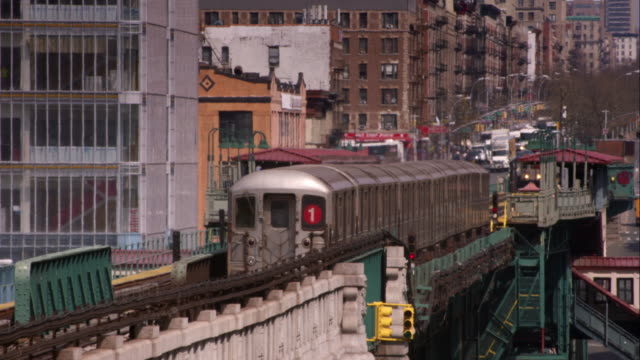 the # 1 subway train comes into the elevated 125th subway stop on broadway. - harlem stock videos & royalty-free footage