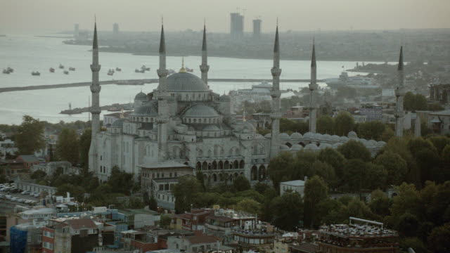 AERIAL The Sultan Ahmet Mosque at Sultanahmet Square with the Bosphorus Strait in the distance / Istanbul, Turkey