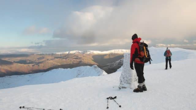 the summit of helvellyn in the lake district, uk in winter conditions. - deep snow stock videos & royalty-free footage