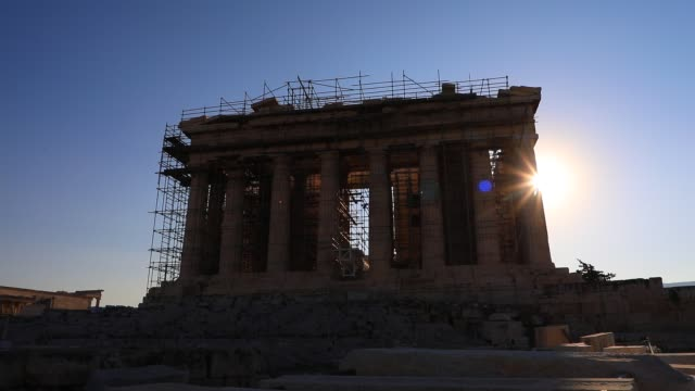 the sun appears behind the parthenon temple at the acropolis on august 23, 2020 in athens. during the coronavirus pandemic, greece is restricting... - atmosphere filter stock videos & royalty-free footage