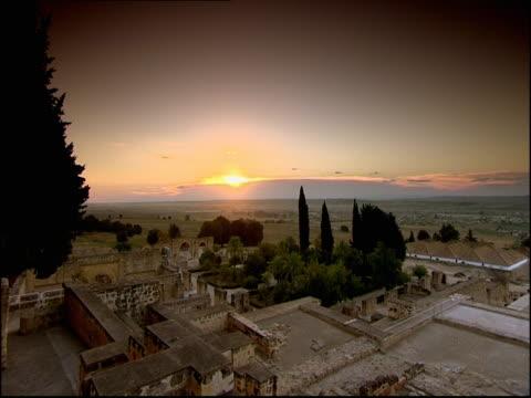 the sun at golden hour shines on medina azahara. - golden hour stock videos & royalty-free footage