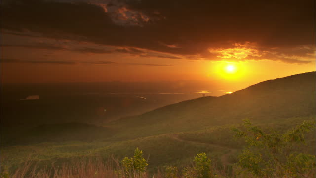 The sun begins to set over the Shire Highlands in Southern Malawi.