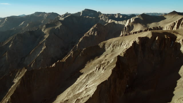 the sun casts shadows across the rugged textures of the high sierras. - basin and range province stock videos and b-roll footage