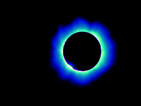The sun crosses in front of the moon for a blue-tinted solar eclipse.