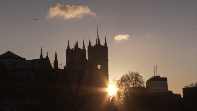 The sun glows bright from Westminster Abbey.