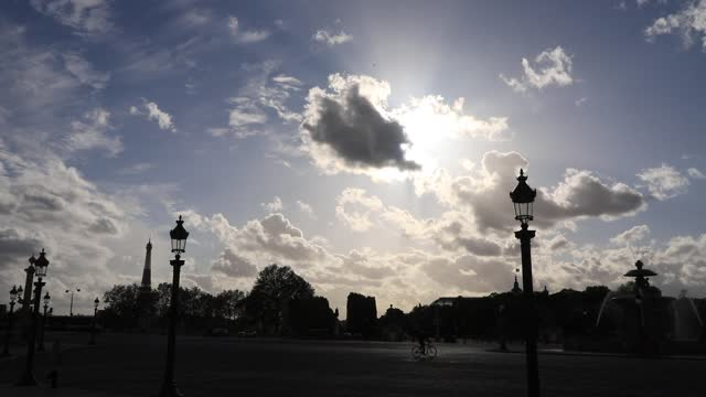 the sun hides behind a cloud, in the foreground the street lamps on the place de la concorde on may 4 in paris, france. in france, the epidemic of... - atmosphere filter stock videos & royalty-free footage