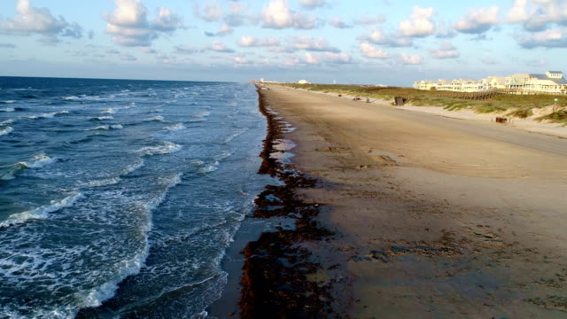 the sun hits the sand on padre island tranquil tropical paradise on the beach drone view - corpus christi texas stock videos & royalty-free footage