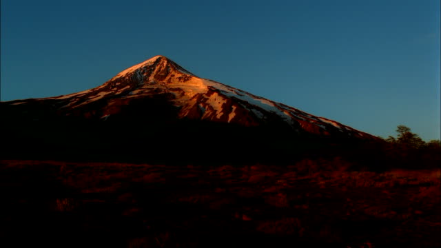 the sun illuminates the beautiful landscape of patagonia. - montagna video stock e b–roll