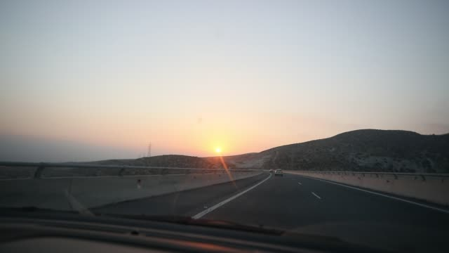 the sun is almost setting at paphos - road trip stock videos & royalty-free footage