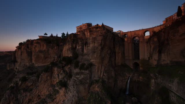 T/L The sun is rising on Ronda's Puente Nuevo bridge / Ronda, Malaga, Spain