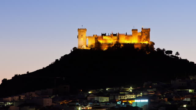 T/L The sun is setting on Almodovar Del Rio's Castle and the village / Almodovar Del Rio, Cordoba, Spain