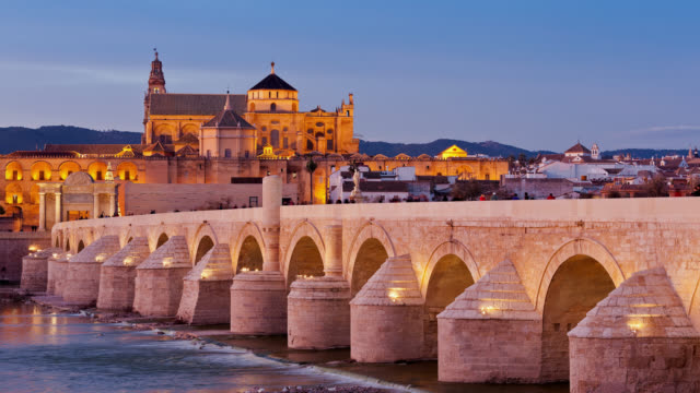 t/l the sun is setting on cordoba's mezquita mosque catedral and on the roman bridge / cordoba, spain - mesquita stock videos & royalty-free footage