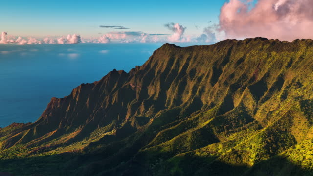 T/L The sun is setting on the Kalalau Valley and the cliffs of the Na Pali Coast