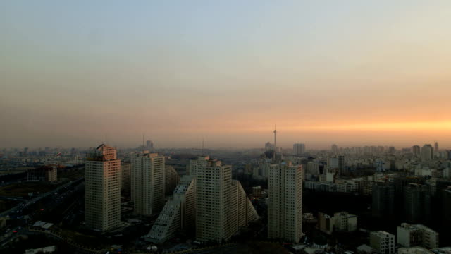 the sun is setting over tehran city and the milad tower - tehran stock videos & royalty-free footage