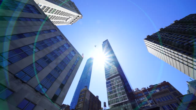the sun is shining from interval of luxury residential condominium towers among the midtown manhattan skyscrapers at new york ny usa on apr. 23 2018. - tower stock videos & royalty-free footage