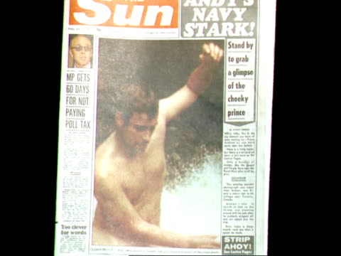 the sun newspaper/ prince andrew's naked photo the sun newspaper/ prince andrew's naked photo cf cms front page of 'the sun' newspaper with... - ヨーク公 アンドルー王子点の映像素材/bロール