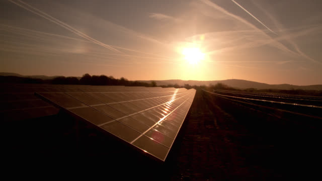the sun passes over photovoltaic panels in saarland, germany. - solar panel stock videos & royalty-free footage