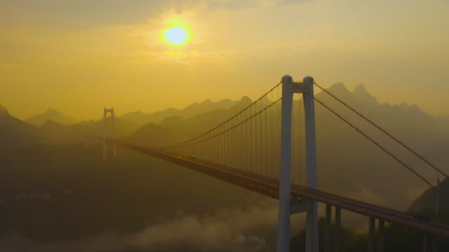 the sun raises over the guanling bridge on march 29 2020 in anshun guizhou province of china - sun stock videos & royalty-free footage