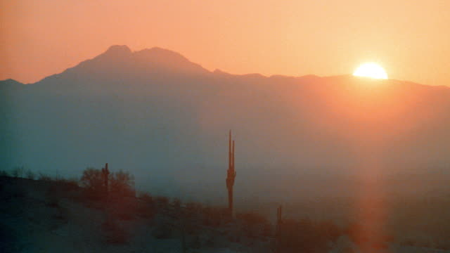 the sun rests on the crest of the mountains near phoenix. - 1990 stock videos & royalty-free footage