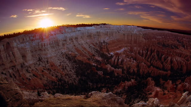 the sun rests on the horizon in bryce canyon national park, utah. - bryce canyon stock videos and b-roll footage