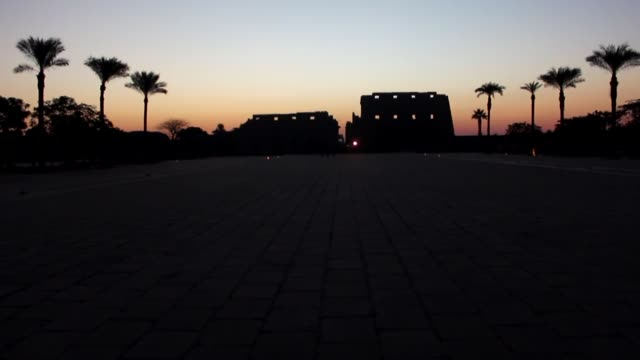 the sun rises behind the temple of karnak during the alignment of the winter solstice sunrise to the temple in the southern egyptian city of luxor on... - temples of karnak stock videos & royalty-free footage
