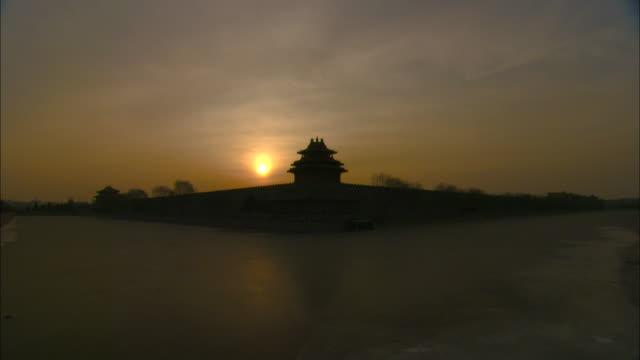 the sun rises beyond beijing's forbidden city. - forbidden city stock videos & royalty-free footage