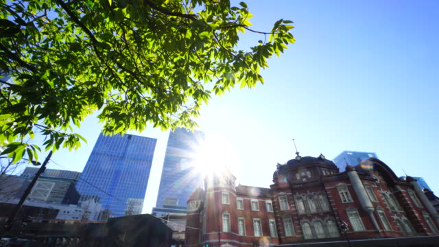 The Sun rises from behind Tokyo Station.