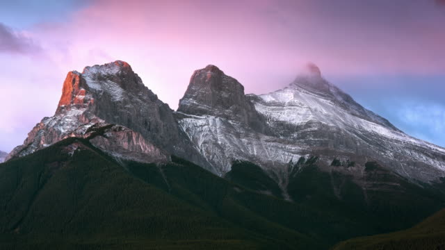 T/L The sun rises on the Three Sisters Mountains