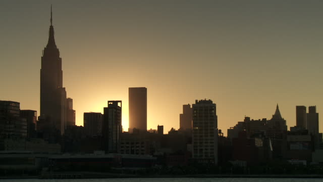 The Sun rises over some building in Midtown Manhattan early morning.