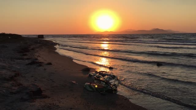 The sun rises over the west coast of Turkey over the Aegean Sea on August 29 2015 in Kos Greece Migrants from many parts of the Middle East and...