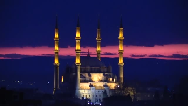 the sun sets behind the selimiye mosque in the northwestern edirne province of turkey on december 25, 2018. - tourism stock videos & royalty-free footage