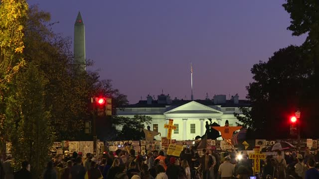 the sun sets in washington after election week as protesters gather outside the white house in black lives matter plaza following us president donald... - protestor stock videos & royalty-free footage