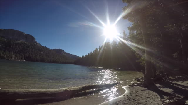 the sun sets over a mountain lake. - slow motion - mammoth lakes video stock e b–roll
