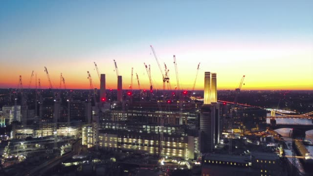 the sun sets over battersea power station as seen by drone the power station is being redeveloped in a multi billion construction project - luminosity stock videos & royalty-free footage