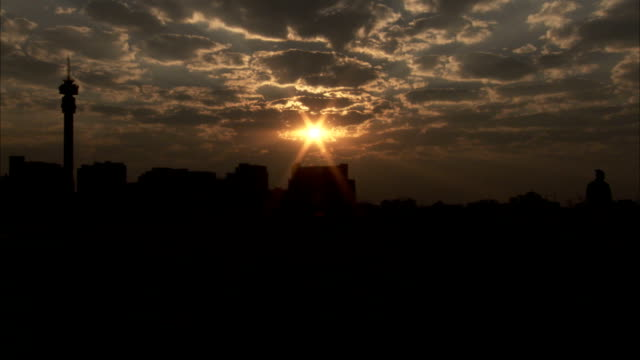 The sun sets over the skyline of a South-African city. Available in HD.