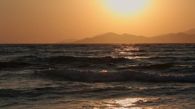 The sun sets over the west coast of Turkey over the Aegean Sea on August 29 2015 in Kos Greece Migrants from many parts of the Middle East and...