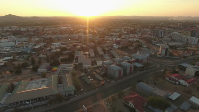 the sun setting over windhoek - namibia stock videos & royalty-free footage